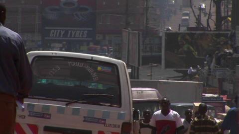 Medium shot of busy traffic on a street in Kampala, Uganda Stock Video Footage