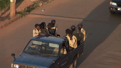 A police patrol drives in traffic on a street in Kampala, Uganda Footage