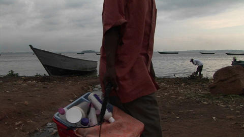 Medium shot of a fisherman working on the shores of Lake... Stock Video Footage