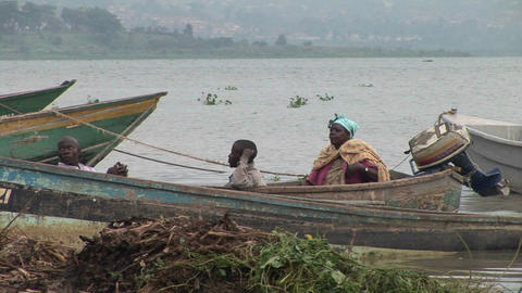 Medium-shot of African fishers resting in a boat on the... Stock Video Footage