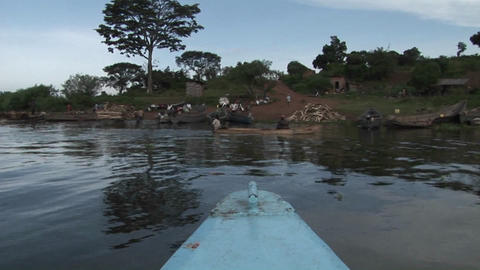 Point-of-view of a fishing boat's departure from the shore of Lake Victoria in Uganda Footage