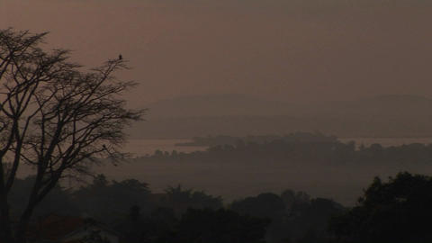 Medium-shot of the dusk, low over Lake Victoria, Uganda Footage