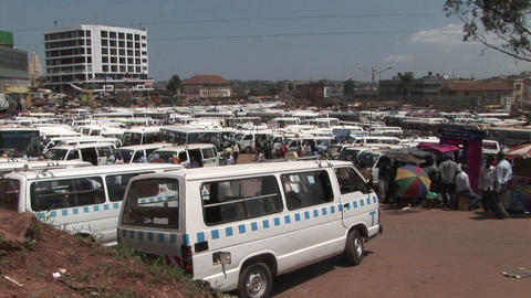 Establishing shot of a crowded bus depot in Kampala, Uganda Footage