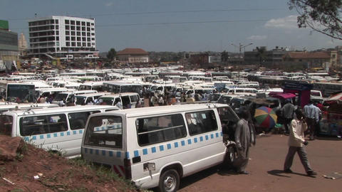 Establishing shot of a crowded bus depot in Kampala, Uganda Stock Video Footage