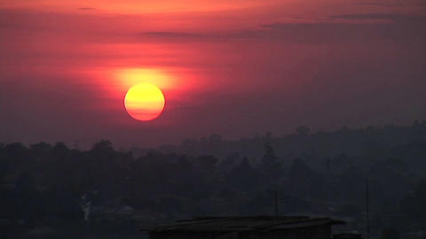 Time Lapse shot of a fiery sun setting over Kampala, Uganda Stock Video Footage