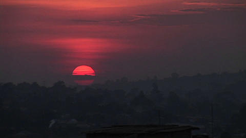 Time Lapse shot of a fiery sun setting over Kampala, Uganda Footage