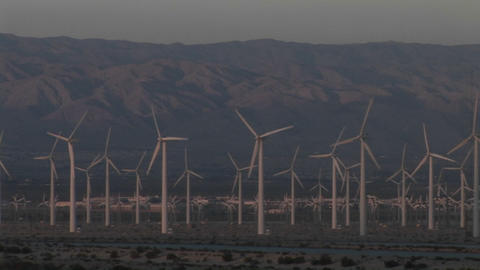 Multiple wind turbines turn in the California desert Footage