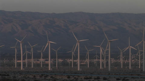 Multiple wind turbines turn in the California desert Stock Video Footage