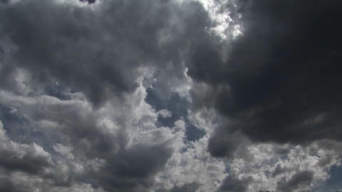 Storm clouds scuttle across the sky Stock Video Footage
