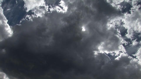 Clouds pass directly overhead against a blue sky Stock Video Footage