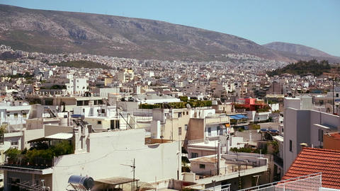 Wide establishing shot of Athens, Greece in sunshi Footage
