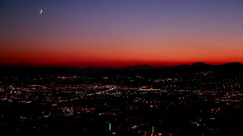 A night sunset shot over a busy city metropolis Footage