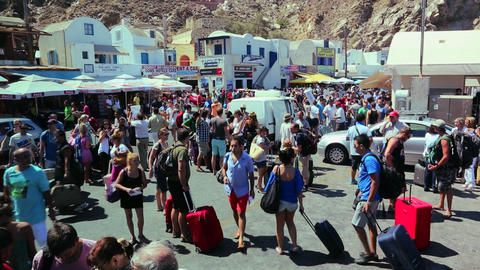 Huge crowds mill around a tourist resort in Europe Stock Video Footage