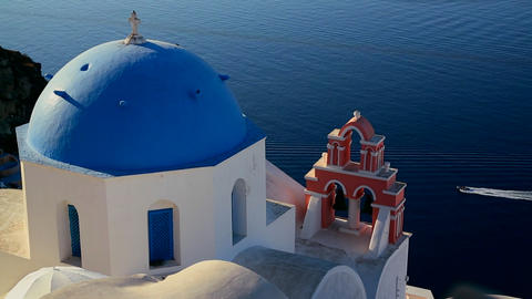 A boat passes a Greek Orthodox church on the Greek Stock Video Footage