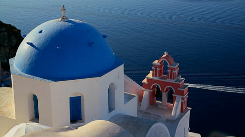 A boat passes a Greek Orthodox church on the Greek Footage