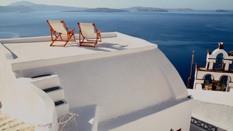 Pan across deck chairs sit on a beautiful balcony Stock Video Footage