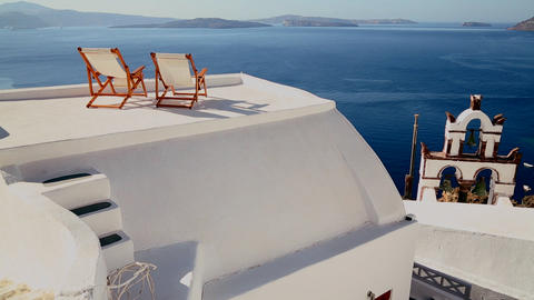 Pan across deck chairs sit on a beautiful balcony  Footage