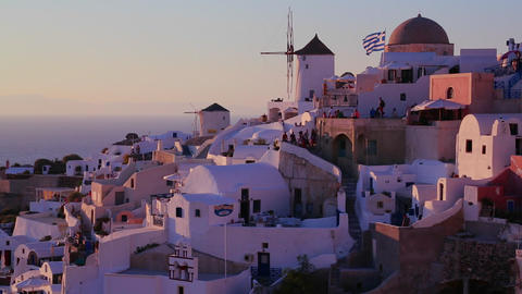 White buildings and windmills line the hillsides o Stock Video Footage
