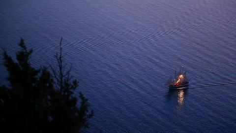 A beautiful sailing ship sails near a coastline at Stock Video Footage