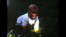 Baby Girl Attempting to Crawl on Grass (8mm vintage home... Stock Video Footage