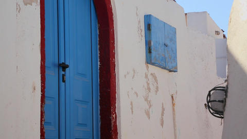 Beautiful whitewashed walls and blue doors on the  Footage