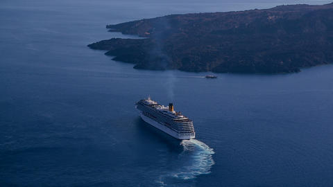The Costa Concordia cruise ship sails close to an  Footage