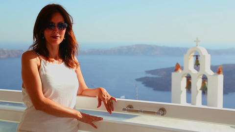 A woman stands before a church on the Greek Island Stock Video Footage
