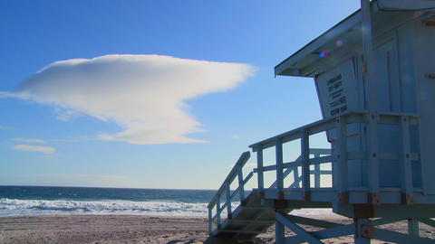 Time lapse of a cloud formation behind a lifeguard Stock Video Footage