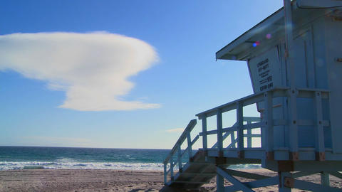 Time lapse of a cloud formation behind a lifeguard Footage