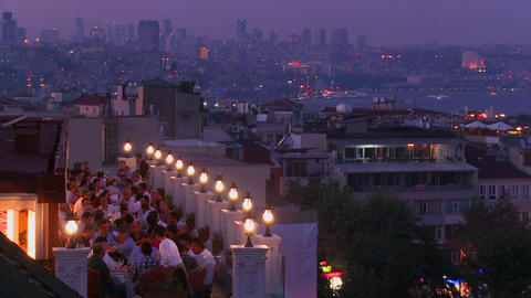 People eating dinner at a rooftop restaurant overl Stock Video Footage