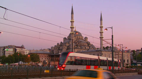 Rapid transit trams and traffic at dusk in front o Stock Video Footage