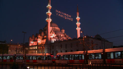 A tram passes in front of a mosque in istanbul, Tu Footage