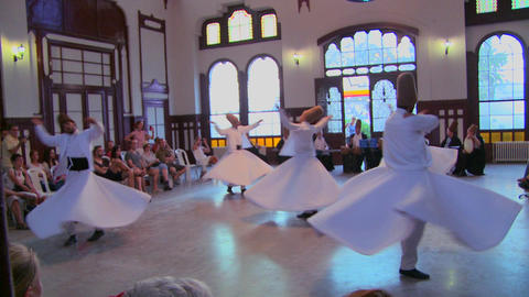A moving shot of whirling dervishes perform a myst Footage