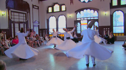 A moving shot of whirling dervishes perform a myst Stock Video Footage