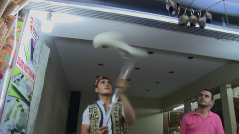 A Turkish ice cream seller makes gooey ice cream i Stock Video Footage