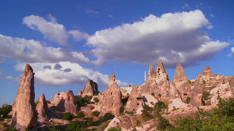 Time lapse over strange towering dwellings and roc Stock Video Footage