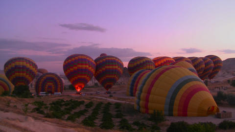 Hot air balloons firing up at dawn Footage
