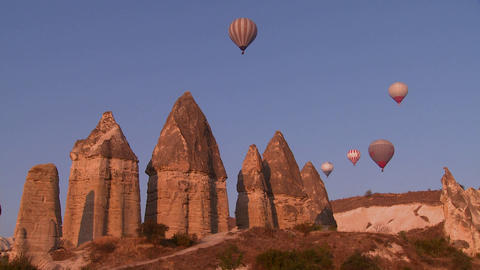 Hot air balloons fly over the magnificent geologic Stock Video Footage