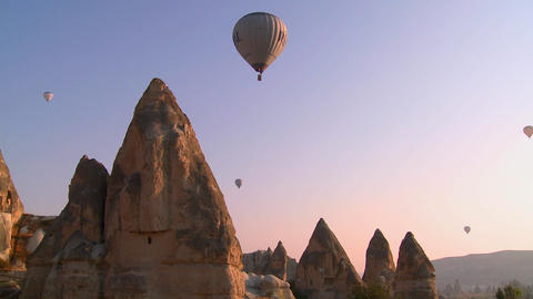 Hot air balloons fly over the magnificent geologic Footage