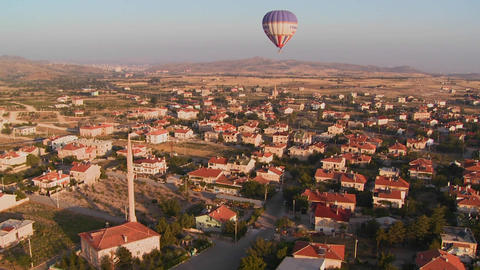 Hot air balloons fly over a neighborhood near Capp Stock Video Footage