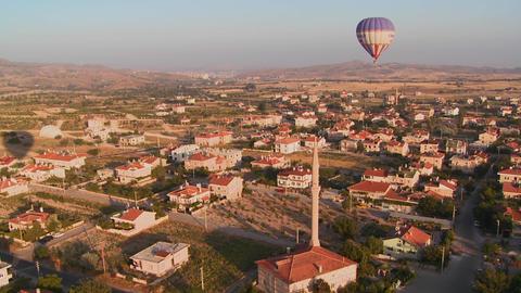 Hot air balloons fly over a neighborhood near Capp Footage