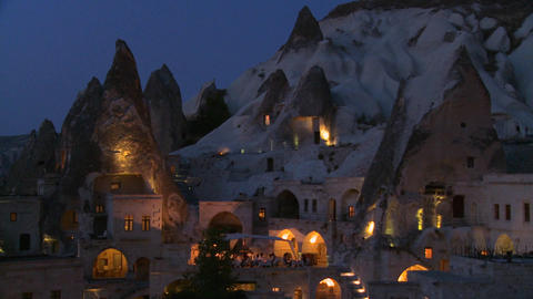 Strange dwellings built into a hillside at dusk or Footage