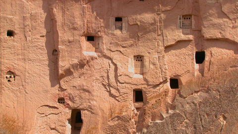 Ancient Christian tombs and carvings on a cliff fa Stock Video Footage