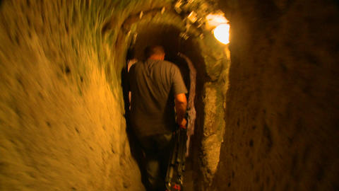 A point of view following a man walking in a tunne Stock Video Footage