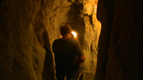 A point of view following a man walking in a tunne Footage