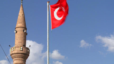 A Turkish flag flies near a mosque Footage