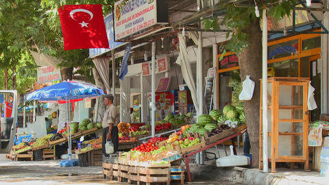 A fruit and vegetable market in a small town in ce Stock Video Footage