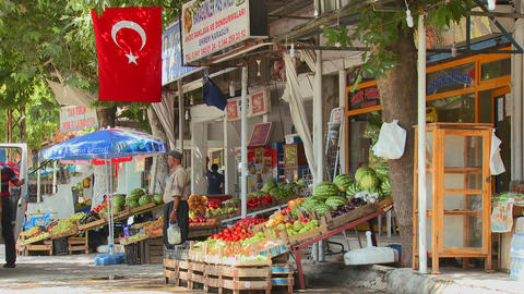 A fruit and vegetable market in a small town in ce Footage