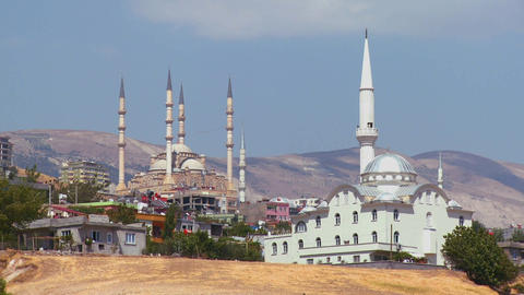 Mosques stand out on the horizon in a remote town Stock Video Footage