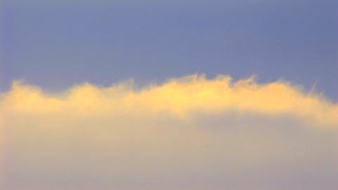 Time lapse shot of clouds moving beneath a blue sky Stock Video Footage